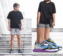 Judas Lee - Alexander Wang Parental Advisory T Shirt, Grey Leather Shorts, Raf Simons For Adidas Originals Formula One 1 Sneakers, Alexander Wang Prisma Leather Pouch - Men I might not know, but shoes...