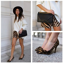 Zina CH - Isabel Marant Heels, Saint Laurent Bag, Emilio Pucci Shorts - Animal Print
