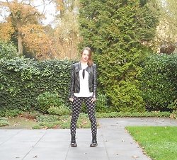 Iris K - Famous Biker Jacket, Bershka Denim Shirt, H&M Printed Pants, Dr. Martens Black - Pink lipstick and a biker jacket
