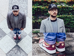 Jeffrey Herrero - New Era Cap, Puma Sneakers, H&M Blazer, Selected Jumper, Zerouv Glasses -  MUSEUM OF COMMERCE