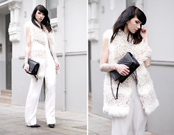 Ricarda Schernus - H&M Jumpsuit, H&M Fake Fur Vest, Chanel Bag Le Boy, Menbur Black Heels - Winter White