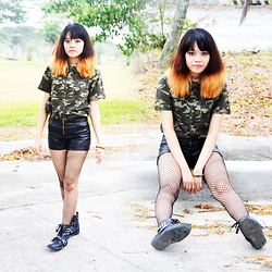 Alixandrea O. - Fifty Percent Studded Camouflage Top, Black High Waist Faux Leather Shorts, Chic Boxroom Black Studded Boots - Comrade