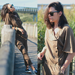 Natalia M - Ray Ban Ray Ban Sunnies, Zara Sporty Jumpsuit, Vans Sneakers - VOYAGE