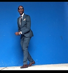 "David Thande - Hugo Boss Captoe Oxford, Zara Ramie Suit, Tiesdotcom Speckle Pocket Square, Rolex Oyster Perpetual, Prada Paisley Print Silk Tie, Warby Parker Thachter -       ""natural volubility dipping only slightly"""