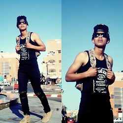Bachir HA - Pyrex Vision Snapback By :, Ray Ban Sunglasses By :, Supreme Backpack By :, Jack Daniel's Sweater By :, All Black Everything Pants By :, Timberland Shoes By : - Blue sky