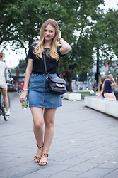 Irina Tschatchina -  - Denim Skirt and a black Shirt