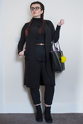 Olivia Lynn - Charity Shop Black Polo, Street Talk Sleeveless Blazer, Asos Peg Trouser, Primark Suedette Boots, Primark Skinny Tan Belt, Zara Reversible Tote, Dune Pom Pom Keyring - All Black Interview