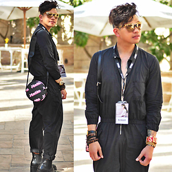 Butch Cervantes - Zara Eyewear, H&M Black Jumpsuit, Moschino Bangle, Moschino Barbie Bag - Dubai Fashion Week 2015