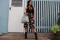 Kelsey Anderson - Fashion Nova Laceup Bodysuit, Sports Girl Floral Culotte Pants, Famous Footwear Black Boot Heels, Ysl Bag - All Laced Up