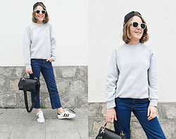 Trini Gonzalez - Ray Ban Sunglasses, Fruit Of The Loom Sweatshirt, Levi's® Jeans, Anya Hindmarch Bag, Adidas Sneakers - Frayed denim