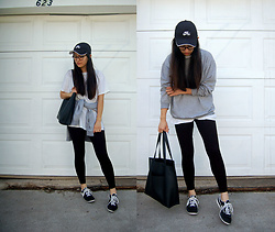 Sheila - Calvin Klein Black Leggings, Hanes White T Shirt, Sweatshirt, Nike Baseball Hat, Nike Sneakers - What to Wear When Traveling