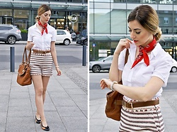 Angelika Rachocka -  - White shirt and striped shorts