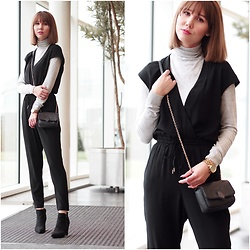 Anastasiia G - Reserved Jumpsuit, Coccinelle Mini Crossbody Bag, Michael Kors Watch, Deichman Ankle Block Heel Boots, H&M Turtleneck - Layer To Stay Warm