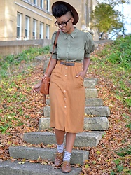 Sushanna M. - Thrifted Brown Hat, Olive Green Puff Sleeve Shirt Dress, High Waisted Tan Skirt, Thrifted Brown Wingtip Oxfords - English Literature