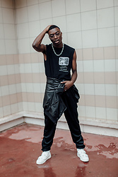 "Marc-Henri Ngandu - Misbhv T Shirt With No Sleeves, Weekday Chains, Weekday Black Leather Bomber, Champion Black Jersey Pant, Limtaeng Studio Brayden White - The ""n"" word"