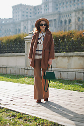 Andreea Birsan - Camel Fedora Hat, Vintage Sunglasses, Camel Teddy Bear Coat, Striped Sweater, Green Suede Crossbody Bag, Camel Flared Pants, Suede Ankle Boots - The faux fur coat that will make you look glamorous II