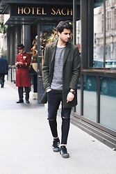 James Adams - Pull & Bear Dark Green Coat, Selected Grey Sweater, Jord Green Wood Watch, Pull & Bear Black Ripped Jeans, Adidas Black Sneakers - Dapper Menswear in Vienna