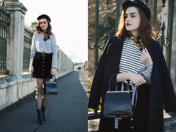 Andreea Birsan - Long Navy Coat, Vintage Bag, Real Suede Button Front Mini Skirt, Newsboy Cap, Vintage Scarf, Striped Top, Gingham Top, Fishnet Tights, Leather Ankle Boots - Not a puffer jacket person? Here's a long coat you will love