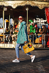 Andreea Birsan - Red Sunglasses, Newsboy Cap, Mint Faux Fur Coat, Yellow Kelly Tote Bag, Light Wash Step Hem Jeans, Adidas Superstar White Sneakers - How to style your graphic tee with a faux fur coat II