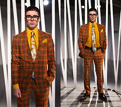 Harry J Bartlett - Bailey Nelson Glasses, Vivienne Westwood Renaissance Tie, J. Crew Pocket Square, Topman Black Leather Belt, Vivienne Westwood Pointy Frame Shoes, Asos Orange Tartan Suit, Vintage Yellow 70s Shirt - The Porn Shop Punk