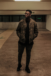 Dee Tshuma - Zara Camo Over Sized Jacket, Zara Camo Joggers, Y 3 Y 3 Qasa High Top Black Trainers, River Island Quilted Black Zip Sweatshirt - Camo Outfit