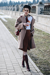 Andreea Birsan - Navy Hat, Graphic Tee, Camel Coat, Brown Midi Wrap Skirt, Red Furla Metropolis Bag, Burgundy Knee High Boots, Fishnet Tights, Silky Scarf - How to wear a wrap skirt during winter