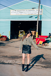Gabrielle L. - Free People Leather Skirt, Anthropologie Casual Oversized Green Top, B. Makowsky Leather Wedge Boots - Scrapyard vibes