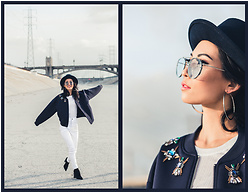 Eunice Kim - Yellow108 Luke Fedora, Zerouv Retro Rimless Color Lens Aviator, Topshop Large Silver Hoops, Arknco Jeweled Neoprene Bomber Jacket, Topshop White Tee, Gjg Denim White Cropped High Rise Jeans, Tony Bianco Diddy Boots - Simply Jeweled