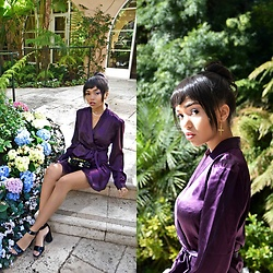 Daphne Blunt - Reformation Purple Silk Wrap Dress, Prada Black Chunky Heel Sandal, Chanel Black Laquer Acrylic Logo Clutch, Luv Aj Gold Crosshoop Earrings, Vida Kush Gold Rose Layered Necklace - Flower Children ?