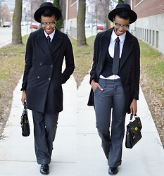 Sushanna M. - Thrifted Black Fedora, Black Double Breasted Coat, Thrifted Grey Tweed Trousers, Black Satchel - Opinion Editorial