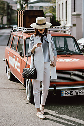 Andreea Birsan - Straw Hat, Striped Top, White Waistcoat, White Suit Pants, Quilted Leather Shoulder Bag, Furry Cream Mules - Styling basics