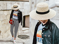 Andreea Birsan - Straw Boater Hat, Graphic T Shirt, Trucker Leather Jacket, Striped Tie Front Pants, Gucci Ace Sneakers, Red Crossbody Bag, White Sunglasses - The best way to pulling off striped pants