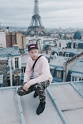Ian Wilkinson - Supreme Plaid 5 Panel, Edwin Sweater, Carhartt Camo Trouser, Nike Air Footscape Woven Chukka - Standin' on this mezzanine in Paris France.