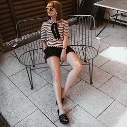 Lary Rauh - Henri Bendel Nude/Brown Sunglasses, Goldknopf Glamorous Crystal Statement Earrings, Zara Chanel Inspired Tweed Top With Bow, Zara Black Mini Skort, Skagen Denmark Black Mini Watch, Jeffrey Campbell Shoes Black Leather Flower Slides - Sweating in Style
