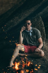 Caleb Paulson - American Eagle Outfitters Red Shorts, Tommy Bahama Brown Hula Shirt, Urban Outfitters White Bandana, Ray Ban Round Frames - Campfire