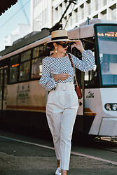 Andreea Birsan - Polka Dot Puffy Sleeves Blouse, White High Waisted Trousers, Straw Boater Hat, Statement Earrings, Black Nirvana Vintage Sunglasses, White Floral Embroidered Mules, Red Lace Trim Shoulder Bag - Puffy sleeves