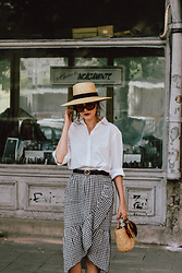 Andreea Birsan - Ruffled Gingham Midi Skirt, Double G Buckle Belt, Mini Straw Bag, Scarf, White Button Down Shirt, Black Oval Sunglasses, Statement Earrings, Straw Boater Hat - The white shirt