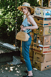 Andreea Birsan - Straw Hat, Scarf, Picnic Basket Bag, Silk Baby Blue Cami Top, Two Tone Step Hem Mom Jeans, Black Flat Mules, Clear Lens Aviator Glasses - Welcome to the farmers market