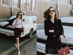Andreea Birsan - Double Breasted Black Blazer, Gucci Ace Heart Embroidered Sneakers, Ruby Red Lace Metropolis Shoulder Bag, Logo T Shirt, A Line Leather Mini Skirt, Square 90s Sunglasses - Transitional dressing