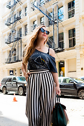 Ashley Hutchinson - Pink Floyd Band T Shirt, Bcbg Striped Palazzo Pants, Mcm Green Tote - Pink Floyd in Soho