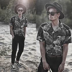 "Edgar - Asos Black Fedora Hat, Vans Black ""Vans Old Skool"" Sneakers, Zara Black Cropped Pants, Primark Black Leather Belt, Midnight Surf Black Floral Shirt, Asos Black Leather Backpack, Asos Black Sunglasses - WEEKEND LOOK"