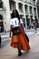 Emma Brown -  - Gap Shirt and orange skirt