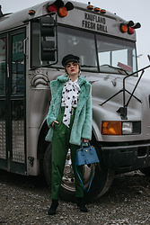 Andreea Birsan - Mint Faux Fur Coat, Baker Boy Cap, Polka Dot Pussy Bow Top, Emerald High Waisted Trousers, Black Heeled Sock Boots, Saffiano Lux Cobalt Bolsa A Mano, Gold Hoop Earrings - Mint coat