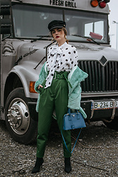 Andreea Birsan - Mint Faux Fur Coat, Polka Dot Tie Bow Top, Baker Boy Hat, Gold Hoop Earrings, Green High Waisted Trousers, Saffiano Lux Cobalt Borsa A Mano, Black Heeled Sock Boots - Tie neck top & mint faux fur coat