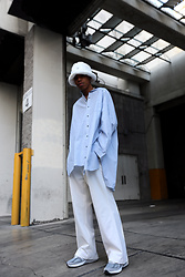 Dominic Grizzelle - Jiieda Oversized Striped Button Up, Kanglo Fuzzy Bucket Hat, New Balance Sneakers - Risk it all