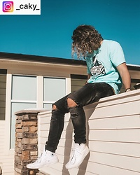 Caleb Paulson - Converse White, H&M Black Jeans, Find Your Coast Teal Surf Shirt - Surf casual