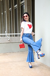 Kristen Tanabe - Comme Des Garçons Play Reverse Heart T Shirt, Topshop Moto Mid Blue Dree Cropped Kick Flare Jeans, Forever 21 Mini Red Crossbody Purse, Marc Jacobs Embellished Denim Platform Heels, Miu Red Sunglasses - Happy Valentine's Day 2018