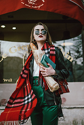 Andreea Birsan - Green High Waisted Trousers, White T Shirt, Black Leather Biker Jacket, Red Plaid Scarf, Red Suede Shoulder Bag, Sunglasses, Gold Hoop Earrings - Red scarf