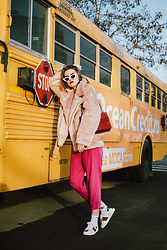 Andreea Birsan - Faux Fur Aviator Jacket, White Cat Eye Sunglasses, Pink Cropped Trousers, Red Suede Shoulder Bag, White Ace Heart Embroidered Sneakers, Socks - It's a pink kind of day