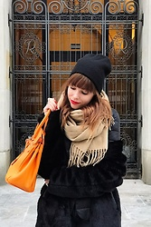 Julita B -  - Orange bag and black coat